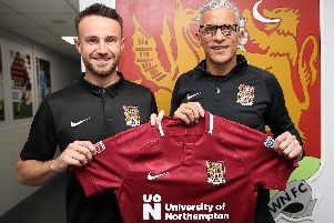 Matty Warburton and Cobblers boss Keith Curle (Picture: Pete Norton)
