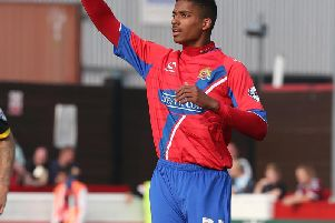 Mason Bloomfield in action for Dagenham and Redbridge in 2014