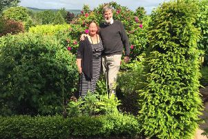 Bill and Rosemary Tustin in their beautiful garden