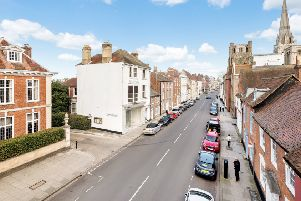The white Grade II listed townhouse in the centre of the photograph is due to be sold by the county council
