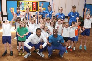 DM1961697a.jpg. Nathan Fox, left and Adrian Patrick, Commonwealth gold medallists visit Springfield Infant School, Worthing. Photo by Derek Martin Photography. SUS-191106-175949008