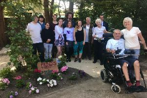 Care for Veterans staff, volunteers and resident Dudley with The Prince's Trust volunteers in the garden at the Boundary Road home for disabled ex-service personnel