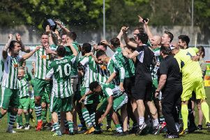 Chichester City players celebrate the title win that secured their promotion to the Isthmian League south east division / Picture by Daniel Harker