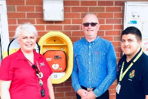 Ali Collett, her husband, Andy Collett and first responder James O'Neill, who used a defibrillator on Andy saving his life moments after CPR had already been done by Ali