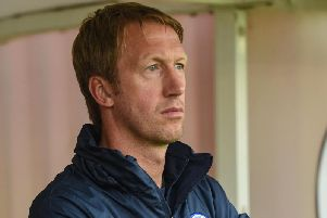 Graham Potter watches on at Crawley Town. Picture by Phil Westlake/PW Sporting Photography