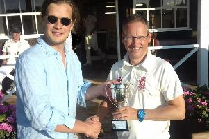 Charlie March hands the 10th Duke of Richmond Memorial Cup to James Mayne