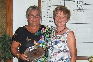 Pictured is Ann Gullick being presented with the trophy by Lady President Ann Hodgson.