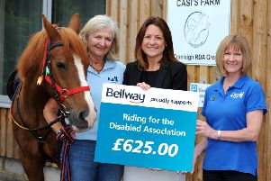 Bellway South London have donated ?625 to the Riding School for the disabled. ''Pictured from left:  Liz Harrison; Cranleigh RDA Chair, Natalie Hughes, Bellway South London sales manager; and Paula Jones, Surrey County Chair'' with horse called Sunny''. Pictures: Ian Scammell SUS-191208-171244001