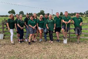 Andrew Riddel  and Tracy Walters (centre) with staff at the Wolds Wildlife Park.