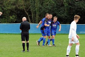 Midhurst celebrate a goal against Selsey last season / Picture by Kate Shemilt