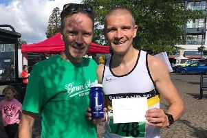 Race winner Andy Hudson with Peter Bryan from Kenilworth Runners.