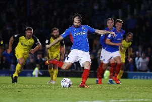 Brett Pitman successfully scored his 10th Pompey penalty to secure a 2-2 draw with Burton. Picture: Joe Pepler