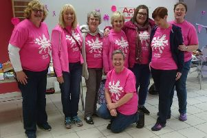 Banbridge Action Cancer Group vonunteers are tickled pink to be celebrating the fifth anniversary of its Paint the Town Pink campaign