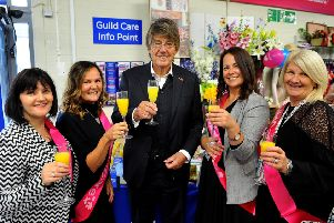 TV and radio presenter Mike Read with Guild Care staff and volunteers. Picture: Steve Robards SR03101901