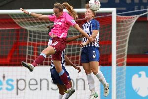 Fliss Gibbons heads clear for Brighton during their defeat against West Ham Ham at the People's Pension Stadium. By Geoff Penn