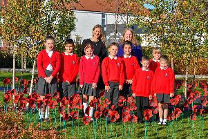 Children from Southwater Junior Academy with Jennifer Rhodes Finch from Berkeley Homes and headteacher Rebecca Toogood SUS-190711-144712001