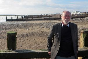 Labour's Jim Deen with Worthing's wooden groynes