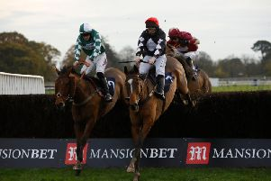 One Of Us gets the better of Captain Cattistock in the run-in of the Southern National / Picture by Clive Bennett