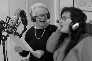 Jacqui Pullen, right, recording the Christmas song