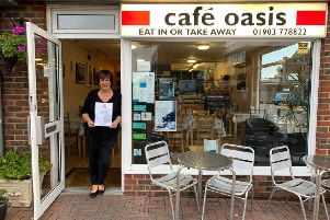 Sarah Clifton, owner of Cafe Oasis, with the Eat Out Eat Well award