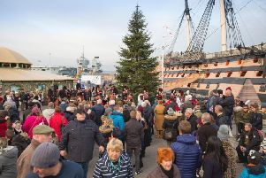 Crowds outside HMS Victory, at Victorian Festival of Christmas, Portsmouth Historic Dockyard