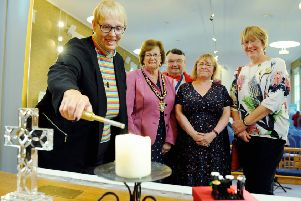 Lighting the candle to launch Worthing Mental Health Awareness Week, Dawn Carn, minister at Offington Park Methodist Church, with Worthing mayor Hazel Thorpe, co'founders Bob Smytherman and Carol Barber, and Val Turner, executive member for health and wellbeing on Worthing Borough Council. Picture: Kate Shemilt ks190553-1