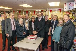 Mac and Naina Patel cut the cake at their silver anniversary celebration on Monday with Post Office staff and customers, as well as mayor of Bognor Phill Woodall, Pam Mosley and chairman of Aldwick Parish Council Lilian Richardson