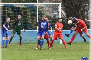 Midhurst, in blue, do battle with Seaford / Picture: Chris Gregory