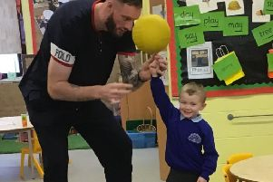 Britain's tallest man Paul Sturgess on a visit to Horsham's Holbrook Primary School SUS-200120-160450001