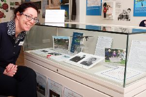 Claire Lucas, Rustington Museum manager, with the display marking the 75th anniversary of Chaucer Avenue plane crash and the 10th anniversary of the Chaucery Memorial. Photo by Derek Martin DM2021728a