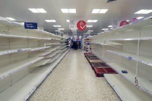 Completely cleared out supermarket shelves. Photo by Mike Hewitt/Getty Images) SUS-200320-114710001