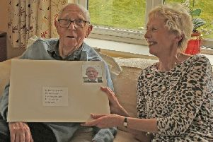 Norman Humble, a founder of the Chanctonbury Probus Club, with his 100th birthday card SUS-200324-145122001