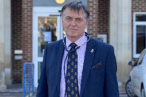 Tim Fooks, the new High Sheriff of West Sussex, outside Pulborough Medical Group, where he has gone back to work as a GP to support the NHS during the coronavirus pandemic