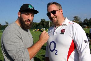 Joe Marler of England, and Harlequins captain sings his autograph on a fans England shirt. Picture by Ron Hill