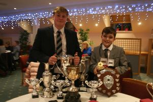 Ed and George Stephenson with their haul of golfing silverware.