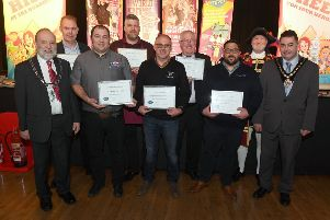 Winners at last year's Caterex trade show at Richmond Centre, Skegness, with former Mayor Coun Danny Brookes (right) and the Town Crier Steve O'Dare (back row). ANL-190131-170602001