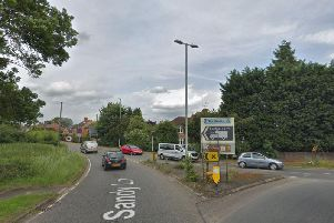 Northamptonshire Police have arrested a man in his twenties after taxi passengers were hit by a vehicle in Sandy Lane, Harpole.