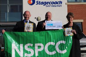 Pictured (from left) Richard Kay, operations director for Stagecoach East Midlands, Mick Forbes, engineering director for Stagecoach East Midlands, and Claire Campbell, community fundraising manager, for the NSPCC, who run Childline.