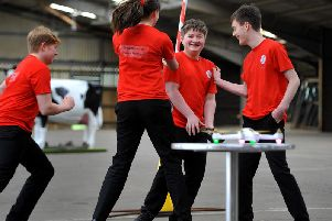 The team from Downlands Community College celebrating their drone's successful flight at the Mid Sussex STEM Challenge