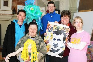 Members of Superstar Arts with artworks including a picture made as a tribute to Martin Dickinson. Photo by Derek Martin DM1932242a