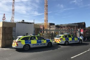 Police outside the Aquerena construction site in Worthing this morning (March 26)