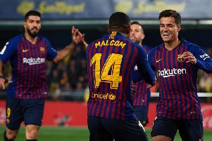 Philippe Coutinho celebrates after scoring his team's first goal with his teammate Malcom during the La Liga match against Villarreal CF(Photo by Manuel Queimadelos Alonso/Getty Images)
