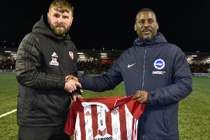 Paddy McCourt presenting a signed Derry City shirt to Brighton  Hove Albion coache Stu Lawrence at the Brandywell on Friday night. DER1419-109KM