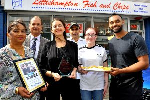 Saty Singh, right, with his parents and staff at Littlehampton Fish and Chips, our Herald and Gazette Takeaway of the Year winner. Picture: Steve Robards SR1909034