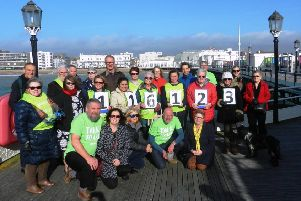 Volunteer from Worthing Samaritans on Worthing Pier, emphasising the free phone number 116 123
