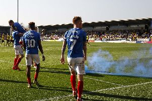 Smoke from the pyro can be seen on the Pirelli Stadium pitch while Pompey celebrate Matt Clarke's winner. Picture: Daniel Chesterton