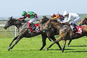 Action at last year's sun-baked season opener at Goodwood / Picture by Malcolm Wells