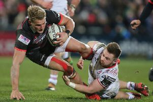 David Busby (right ) in action during a PRO14 League game last season before he suffered a serious knee injury