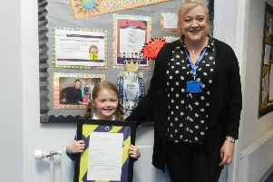 Ava Yeates with teacher Alison Pernet, who runs the literacy group