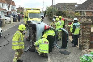 Firefighters rescued two people who became trapped in the collision